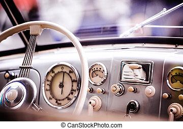 Close up of veteran car, dashboard, windshield, steering...