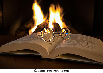 vintage eyeglasses on open book