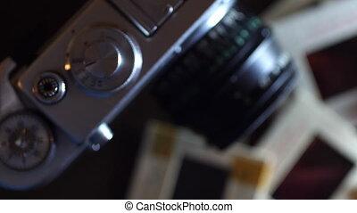 Close up of vintage film camera and slide films