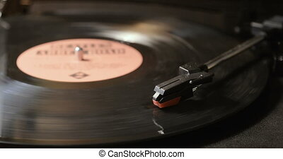 Close up of vinyl record on DJ turntable record player