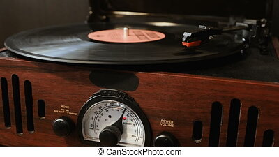 Close up of vinyl record on DJ turntable record player -...