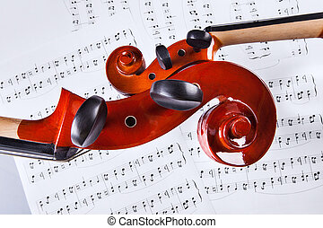 Violin And Cello Over Musical Notes - Close-up Of Violin And...