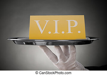 Waiter Showing Vip Text On Banner