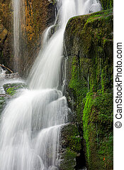 close up of waterfall cascade over the mossy rock. beautiful...