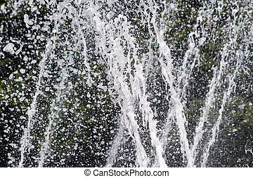 Close up of waterfall in the city pond