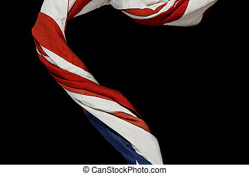 Close up of waving national usa american flag on black background.