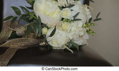 Close up of wedding bouquet on a chair