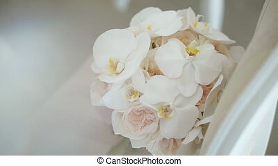Close up of wedding bouquet with delicate pink flowers. Elegant beautiful bridal posy. Wedding symbol. Detail view on bunch of roses and orchids. Slow motion.