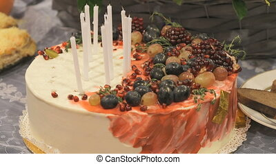 Close-up of wedding cake with extinguished candles