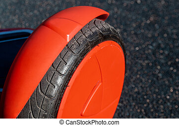 Close up of wheel of self-balancing scooter