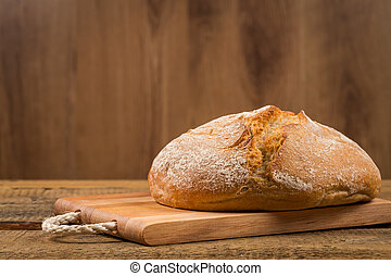 white bread over wooden background