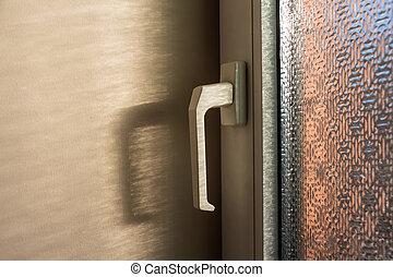 Close-up of white doorknob