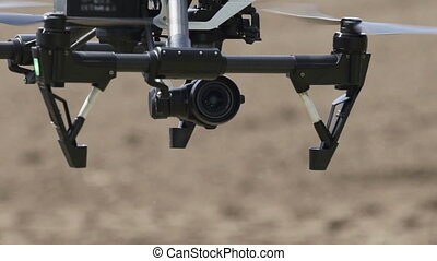 Close up of White drone flying on agricultural field...