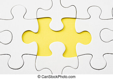 jigsaw puzzle - Close-up of white jigsaw puzzle chipped one...