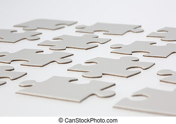 Close-up of White Jigsaw Puzzle Pieces