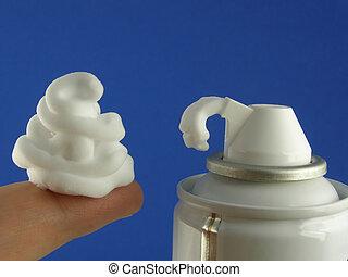 close-up of white shaving foam on top of finger
