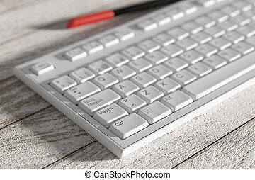 Close-up of white spanish keyboard on wooden table
