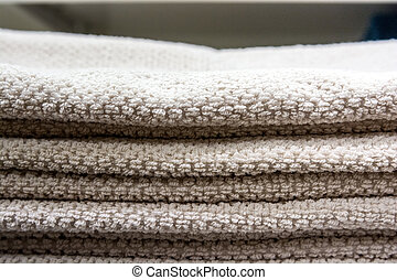Close up of white towels on shelf