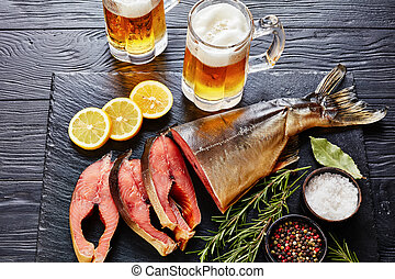close-up of wild salmon, fresh foamed beer