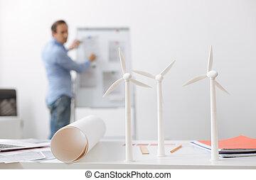 Close up of wind turbines models on engineers table