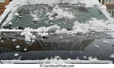 Close-up of windshield of car during the snowfall - Close up...