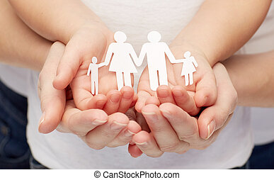 close up of woman and girl hands with paper family