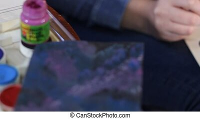 hands painting - close up of woman artist hands painting a...