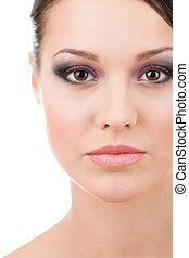 Close up of woman beautiful face, isolated on white. Fashionable makeup