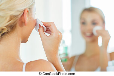 close up of woman cleaning face at bathroom - beauty, skin ...
