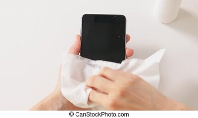 close up of woman cleaning smartphone - hygiene, cleaning ...