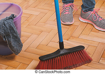 Close up of woman cleaning the floor