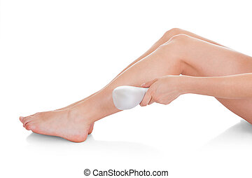 Woman Doing Leg Laser Treatment - Close-up Of Woman Doing...