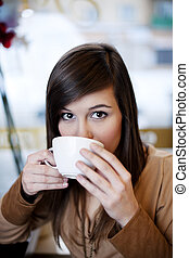Close up of woman drinking coffee