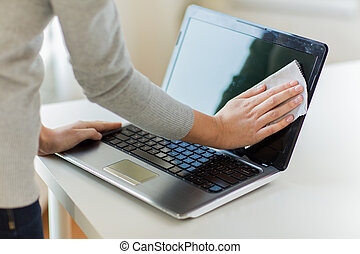 close up of woman hands cleaning laptop screen - people,...