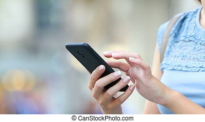 Close up of woman hands using a smart phone