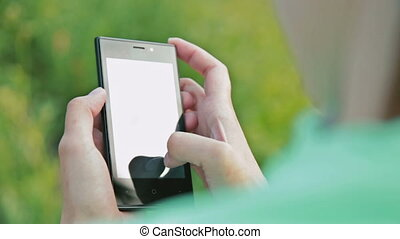 Close up of Woman Hands Using Smartphone in Beautiful Nature