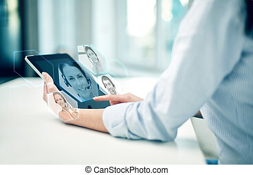 close up of woman hands with tablet pc at office