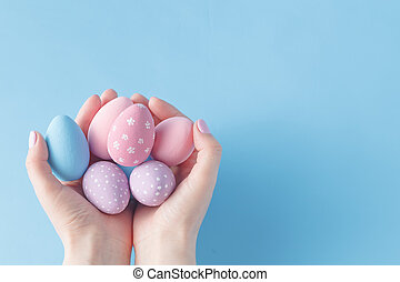 Close up of woman holding colorful Easter eggs
