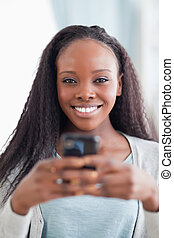 Close up of woman holding smartphone