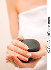 Close-up of woman holding stones