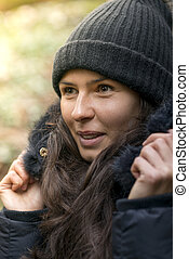 Close Up of Woman in Beanie Hat and Winter Jacket Outdoors