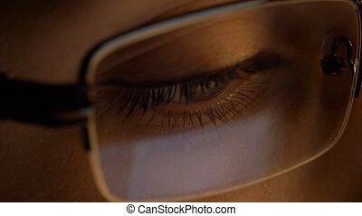 close up of woman in glasses looking at screen - vision,...