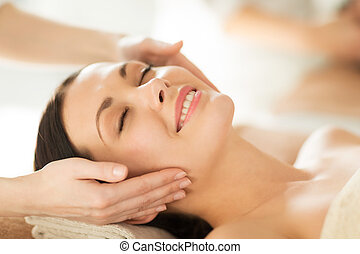 woman in spa - close up of woman in spa salon getting face ...