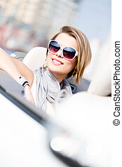 Close up of woman in the automobile - Close up of smiley...