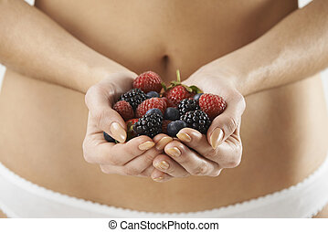 Close Up Of Woman In Underwear Holding Fresh Summer Berries