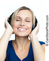 Close-up of woman listening to music with headphones on
