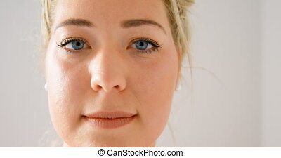 Woman looking at camera in fitness studio 4k