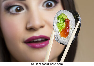 Close up of woman looking at sushi