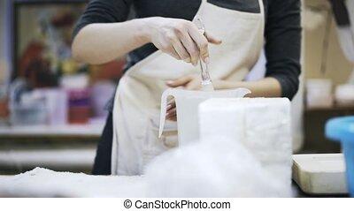 Close up of woman making gypsum