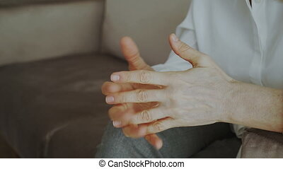 Close-up of woman nervously moving and gesturing hands...